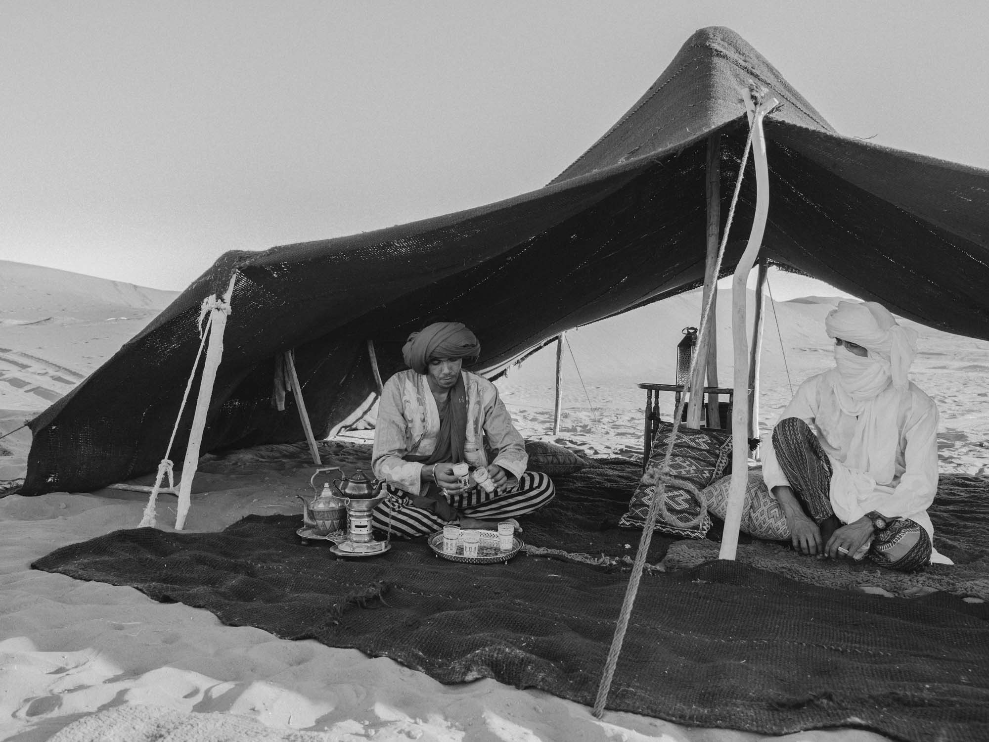 Berber Tour Guides Preparing Tea Under the Shade of Desert Camp