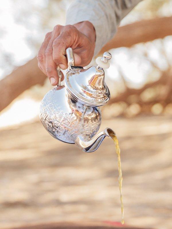 Serving Authentic Moroccan Tea at Desert Camp