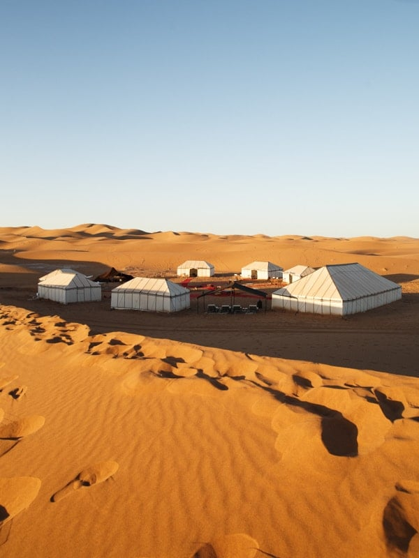 Daylight View of the Desert Camp in Shadow at Erg Chigaga, Morocco
