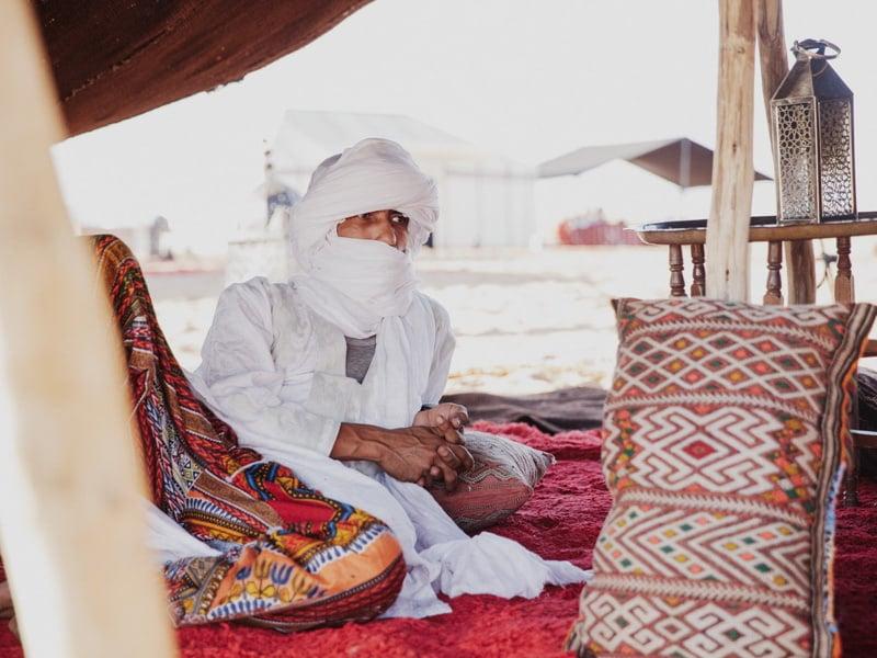 Berber Guide in Traditional Dress Relaxing at Desert Camp