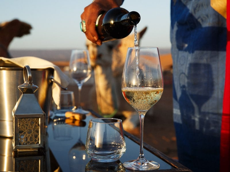 Fine Wine Being Served Special Occasion at Luxury Desert Camp