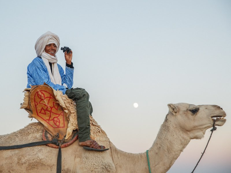 Beldi Tour Guide Sitting On Camel With Binoculars