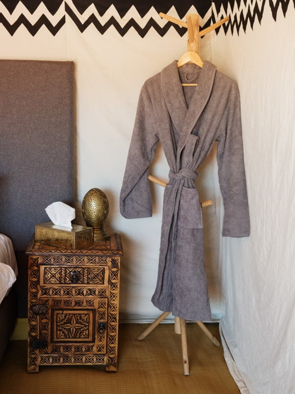 Complimentary Dressing Gown and Bedside Cabinet at Morocco Camp