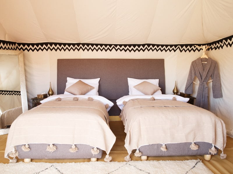 Luxury Bedroom With Twin Beds at Desert Camp Morocco