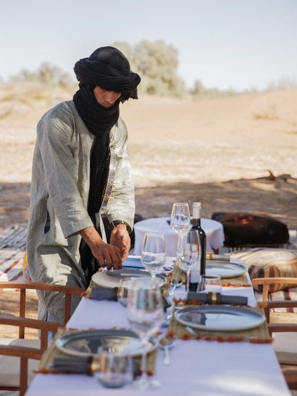 Berber Guide Preparing the Dining Table for Moroccan Desert Picnic