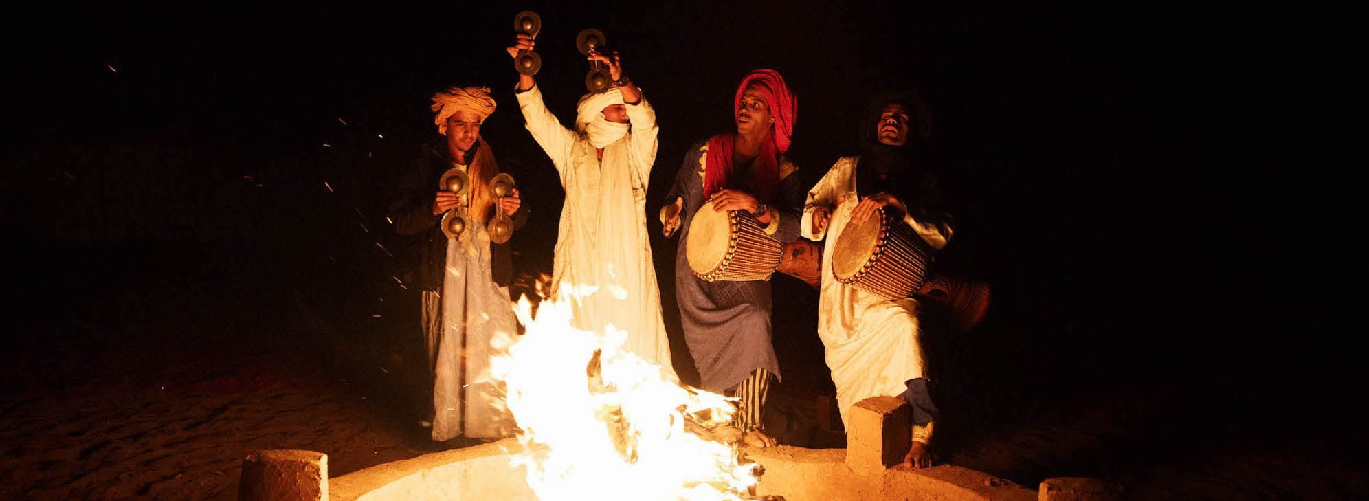 Traditional Ceremony with Drums by Camp Fire at Moroccan Desert Camp