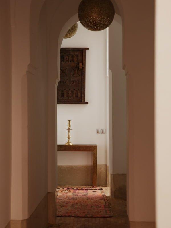 Rug on Floor of the Stone Corridor Hallway in Marrakech Hotel